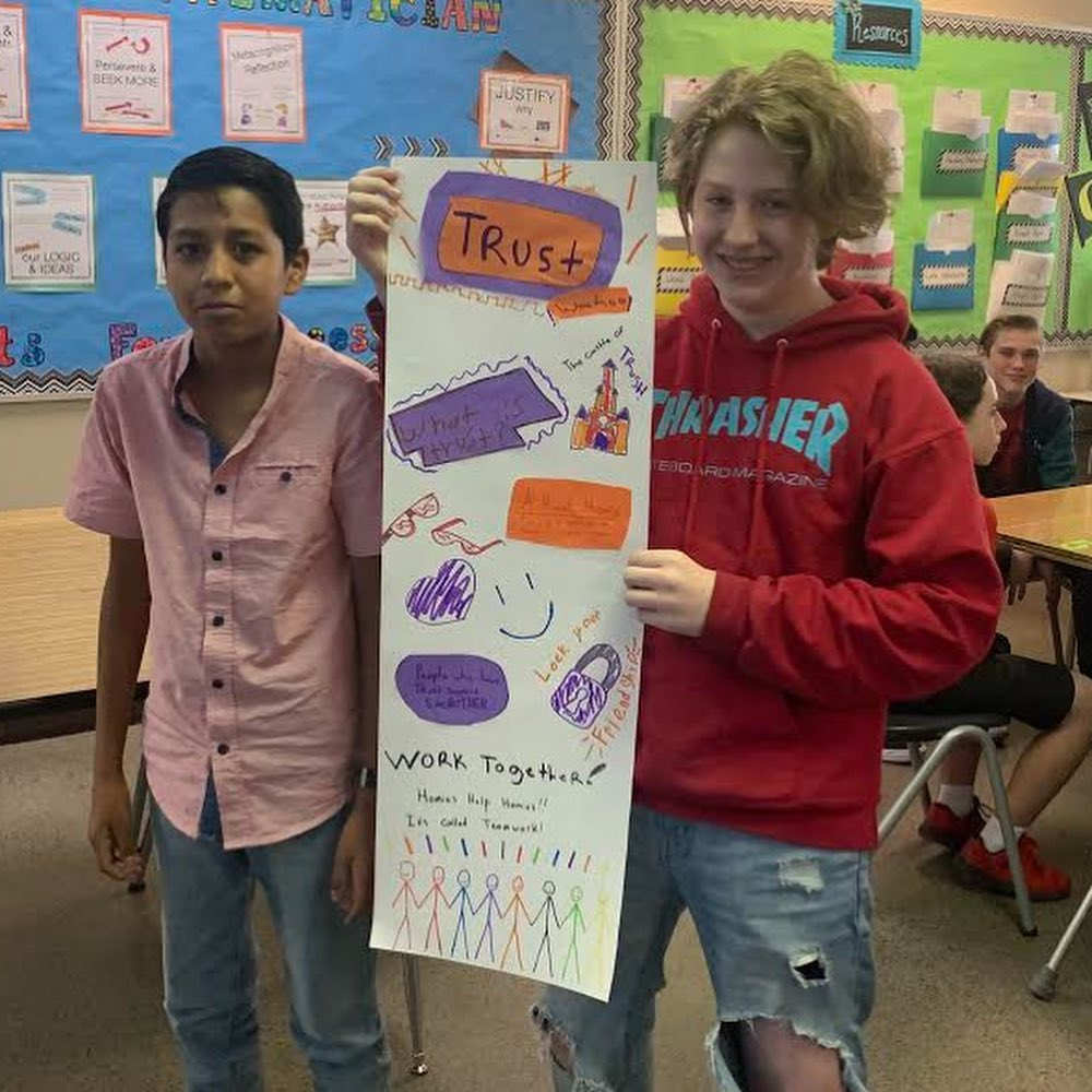 oms students holding poster